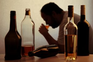 Alcoholic drinking alone in the dark